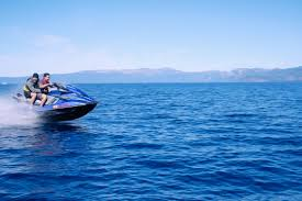 jet ski racing across calm blue sea