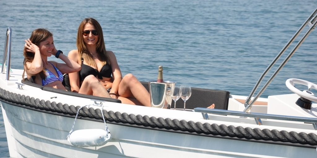 two women enjoying a hire boat from Puerto de Alcudia