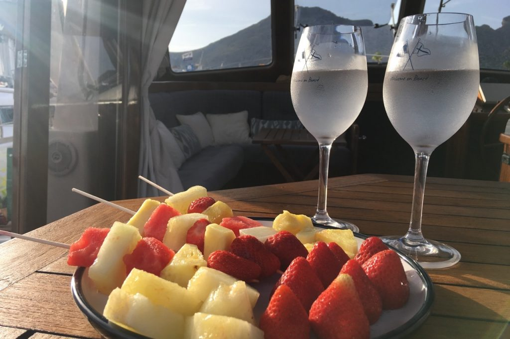 fruit kebabs and refreshing drinks served on a boat